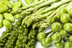 Green asparagus, Sator beans, peppercorns and eggplants, close up Royalty Free Stock Image