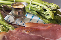 Green Asparagus with Sauce Hollandaise and Ham Stock Images