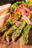 Green asparagus with serrano ham stock photography
