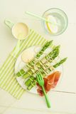 Green asparagus skewers with spaghetti Stock Image