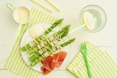 Green asparagus skewers with spaghetti Stock Photos