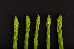 Green Asparagus on Slate Stock Photos
