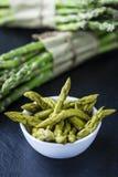 Green Asparagus on a slate slab Stock Photos