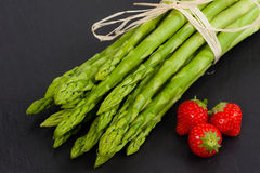 Green Asparagus and strawberries Stock Image