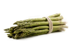 Green asparagus tied together with ribbon isolated on white back Royalty Free Stock Photo
