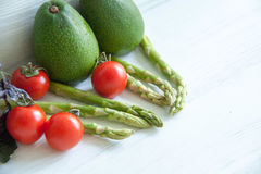 Green asparagus with tomatoes Stock Image