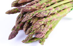 Green asparagus on white background, healthy eating Stock Photo