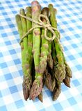 Green asparagus on white and blue checkered background Stock Photo