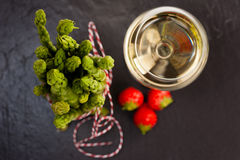 Green Asparagus with white wine and strawberries Stock Photos
