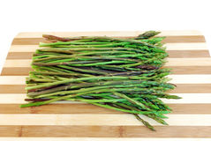 Green asparagus with a wooden cutting board Stock Photo