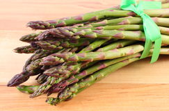 Green asparagus on wooden surface, healthy eating Stock Photography