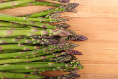 Green asparagus on wooden surface, healthy eating Royalty Free Stock Photography