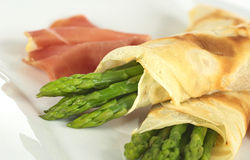 Green Asparagus Wrapped in Crepes Royalty Free Stock Photos