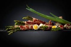 Green Asparagus Wrapped In Bacon Stock Photos