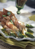 Green asparagus wrapped in Parma ham Stock Photography