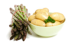 Green asparagus and young potatoes Stock Photo