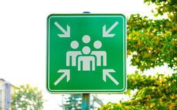 Green assembly point or meeting sign close up in nature. Stock Photo