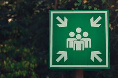 Green assembly point or meeting sign royalty free stock photos