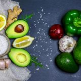 Green assortment vegetables and fruits, avocados, pepper and rucola salad on a shale board, Fitness food. Superfoods, top view royalty free stock photo