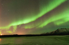 Green Aurora Over Mountains And A Frozen Lake Stock Images