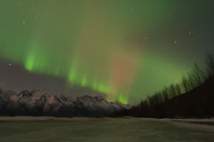 Green Aurora Over Mountains And A Frozen Lake Royalty Free Stock Photo