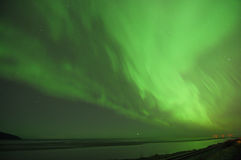 Green Aurora Over Cook Inlet. Green Aurora lights up the sky and water over Cook Inlet Royalty Free Stock Photo