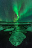 A green aurora  over the Jokulsarlon lagoon, Iceland Stock Images