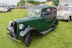 1934 Green Austin carl. MANCHESTER UNITED KINGDOM - JULY 11 2015: 1934 Green Austin classic car. July 2015 stock photography