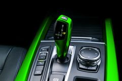 Green Automatic gear stick of a modern car. Modern car interior details. Close up view. Car detailing. Automatic transmission leve stock photography