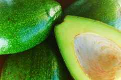 Green avocado. S, one of them cut Royalty Free Stock Photos