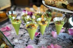 Green avocado cocktail shots served on catering buffet table.  royalty free stock photography