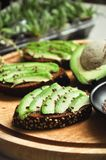 Green avocado toast with flax seeds stock photos
