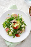 Green Avocado Salad with arugula, grapes and blue cheese Royalty Free Stock Photo