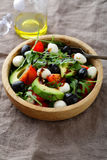 Green Avocado Salad with cherry tomatoes, olive, mozzarella and Royalty Free Stock Images