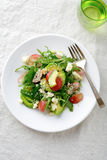 Green Avocado Salad with grape and arugula Stock Photos