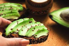 Green avocado toast with flax seeds stock image