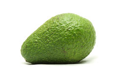 Green avocado on white background Royalty Free Stock Photo