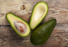 Green Avocado on Wood Stock Image