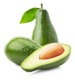 Green avocados with leaves isolated on the white background Royalty Free Stock Photos