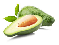 Green avocados with leaves isolated on the white background Royalty Free Stock Images