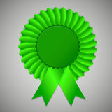 Green award ribbon rosette on gray background Stock Images