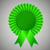 Green award ribbon rosette on gray background Stock Images