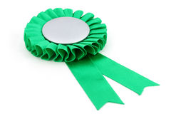 Green award ribbons badge. With white background Royalty Free Stock Images