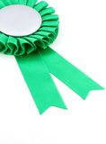 Green award ribbons badge. With white background Stock Photo