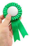 Green award ribbons badge. With white background Stock Photos