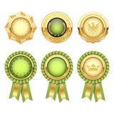Green award rosettes with gold heraldic medal Stock Photos