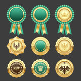 Green award rosettes and gold medals - prize Stock Images