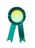 Green award winning ribbon rosette isolated on white background. Green award winning ribbon rosette isolated Royalty Free Stock Images