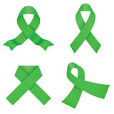 Green awareness ribbons  on a white background Royalty Free Stock Photography