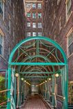 The Green Awning. Green awning over a side walk that goes up to a apartment building Royalty Free Stock Image